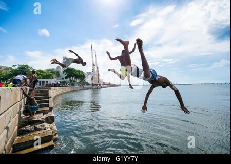 RIO DE JANEIRO - FEBRUARY 25, 2016: Young Brazilians jump into Guanabara Bay from a wall at Maua Plaza at Porto - Stock Photo
