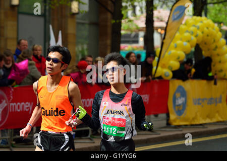 Visually impared competitor with Guide, 2016 Virgin Money London Marathon, London, United Kingdom - Stock Photo
