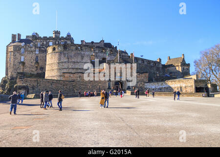 Front view of Edinburgh Castle on a bright sunny day with many tourists visiting - Stock Photo