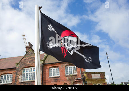 Jolly Roger Pirate Flag, Scarborough North Yorkshire UK - Stock Photo