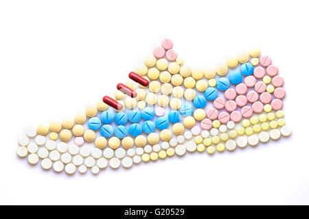 Creative medicine and health care concept made of drugs and pills, in the shape of running shoes. - Stock Photo