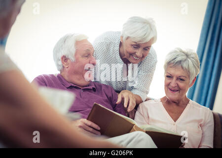 Seniors looking at pictures - Stock Photo