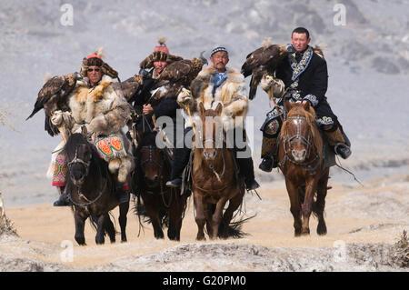 Eagle hunters on route to the Eagle Hunters festival near Ulgii in western Mongolia October - Stock Photo
