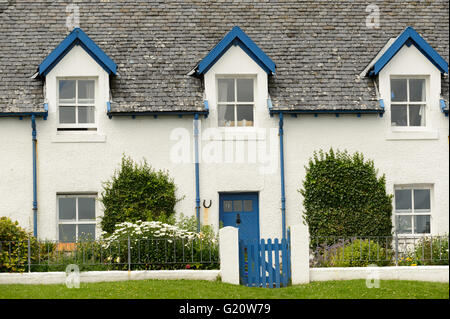 White and blue houses on Isle of Iona, Scotland - Stock Photo