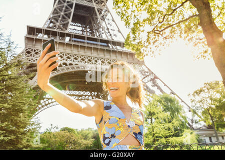 Young woman visiting Paris - Stock Photo
