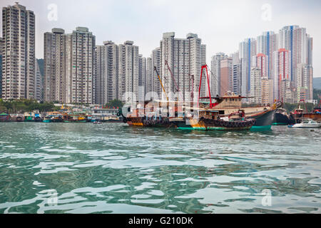 Traditional fishing trawlers in the Aberdeen bay, famous floating village in Hong Kong - Stock Photo