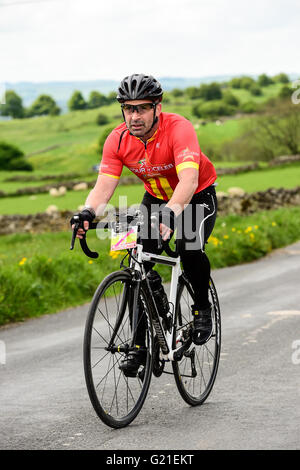 Peak District, Derbyshire, UK. 22nd May, 2016. Celebreties riding the Bostin Peaks Cycle Sportive with other team - Stock Photo