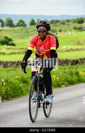 Peak District, Derbyshire, UK. 22nd May, 2016. Celebrities riding the Bostin Peaks Cycle Sportive with other team - Stock Photo