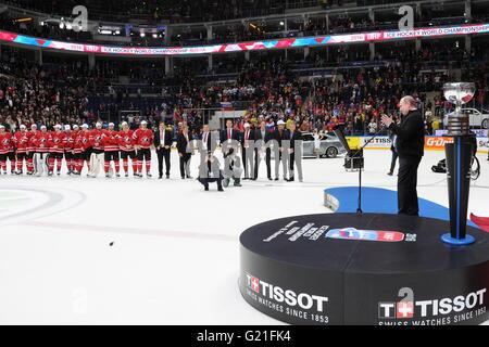 Russia's President Vladimir Putin (R) speaks during an awards ceremony following the 2016 IIHF World Championship - Stock Photo