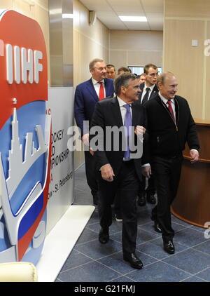 Rene Fasel, president of the International Ice Hockey Federation (IIHF), and Russia's President Vladimir Putin (L - Stock Photo