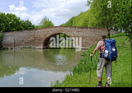 Pilgrim making the road to St Jacques De Compostelle along the Canal Du Midi near Toulouse, Midi-Pyrenees, France - Stock Photo