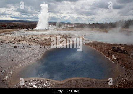 Hot springs, high temperature area in the valley Haukadalur, front Blesi-thermal spring, behind the outbreak of - Stock Photo