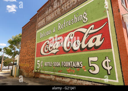 Old Coca Cola sign painted on a building in downtown Laurens, South Carolina. - Stock Photo