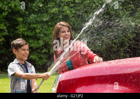 Mother and Son washing a vehicle
