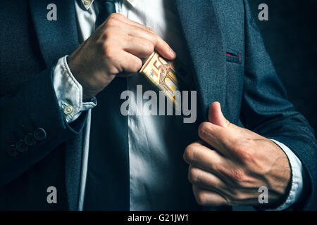 Money in pocket, businessman putting euro banknotes in suit pocket, bribe and corrupution concept. - Stock Photo
