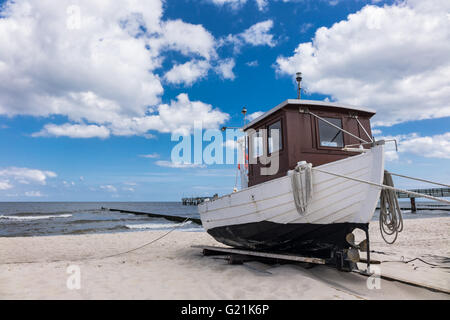 A fishing boat on shore of the Baltic Sea in Koserow (Germany) - Stock Photo