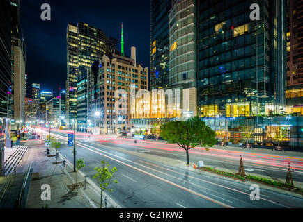 Modern buildings along University Avenue at night, in the Financial District, Toronto, Ontario. - Stock Photo