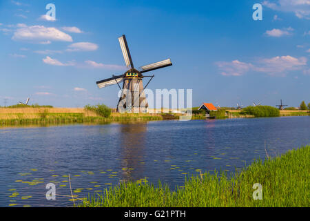Windmills reflected in the Dutch canals at Kinderdijk, UNESCO site in the Netherlands - Stock Photo