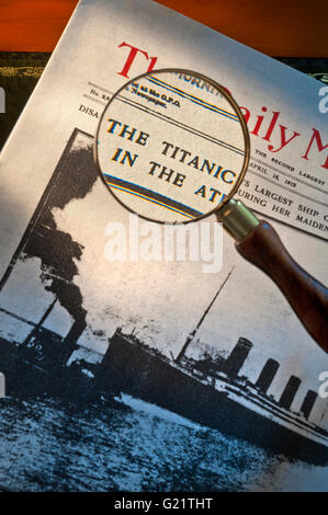 Front page of Daily Mirror dated April 16th 1912 with headline on Titanic disaster with magnifying glass viewing - Stock Photo