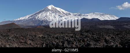 Beautiful volcanic landscape of Kamchatka: panoramic view on lava field active Tolbachik Volcano. Russia, Kamchatka - Stock Photo