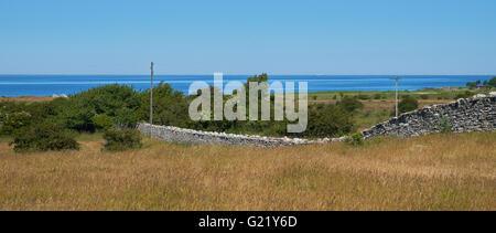 Stone wall KarlXgustavs Mur from 1865, Isle if Oeland, province Kalmar, Sweden - Stock Photo