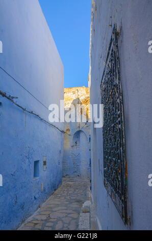 Oriental narrow street with blue houses in Medina, Hammamet Tunisia. - Stock Photo