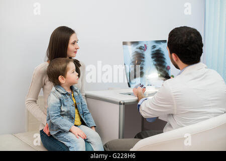 mother and kid on reception at the child pediatrician - Stock Photo