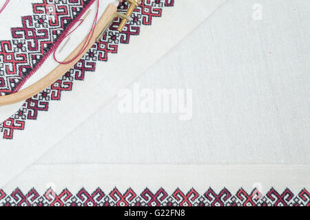 Fragment of embroidery on linen and accessories - Stock Photo