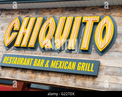 Chiquito restaurant sign on outside wall UK - Stock Photo