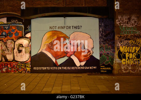 Bristol, UK. 23rd May, 2016. Bristol Stokes Croft. Brexit Street Art, Donald Trump lands a Kiss on Boris Johnson - Stock Photo