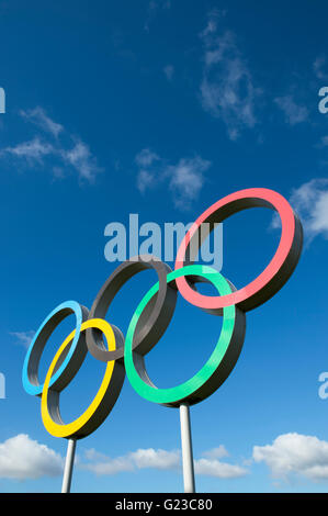 LONDON - OCTOBER 14, 2015: A large display of the five interlocking Olympic rings stand in the Queen Elizabeth Olympic - Stock Photo