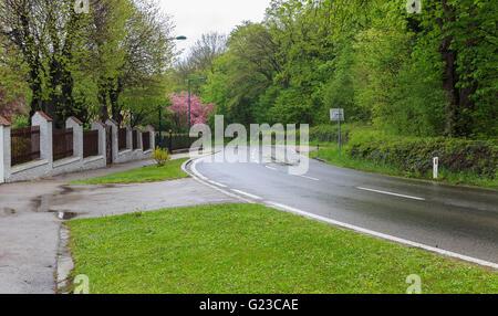 Street in the town of Maria Enzersdorf in rainy weather.Vienna, Austria - Stock Photo