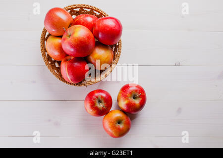 few apples on a white background with the basket - Stock Photo
