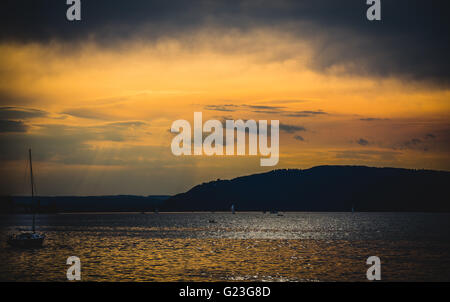 boats on sunset at lake constance - Stock Photo