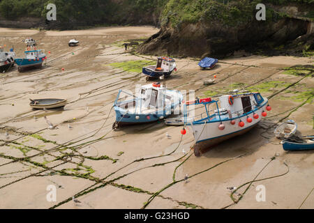 Fishing boats aground at low tide at the harbour in Newquay Cornwall Great Britain UK - Stock Photo