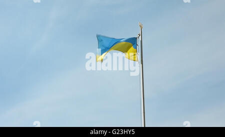 Ukrainian national flag flying waving on flagpole - Stock Photo