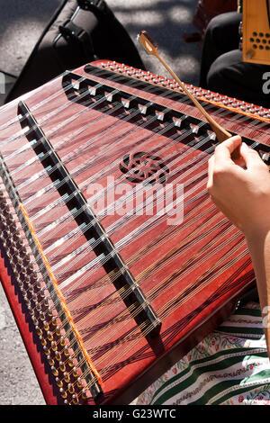 Dulcimer playing folk music - Stock Photo