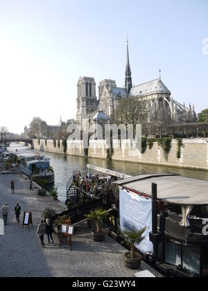 Notre Dame de Paris cathedral in french capital, Paris is in the center of the city near river la Seine - Stock Photo