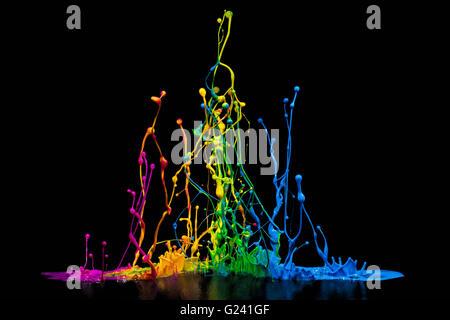 Abstract Paint Splash isolated on black - Stock Photo