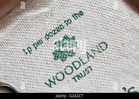1p per dozen to the Woodland Trust - information on carton of 6 free range woodland eggs by Sainsburys - Stock Photo