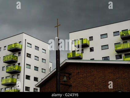 Local authority housing and church. - Stock Photo