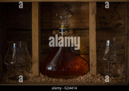 Bottle of brandy with two glasses on the Neuras Wine Estate in Namibia - Stock Photo