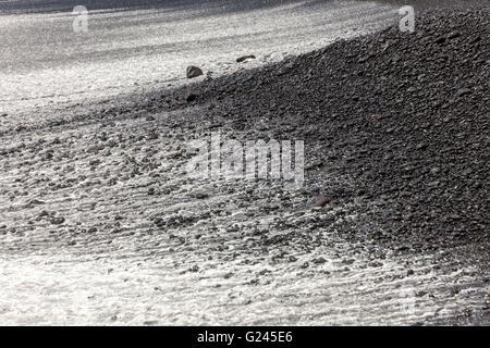 Black volcanic pebbles on beach, Playa Janubio, Lanzarote, Canary Islands, Spain - Stock Photo