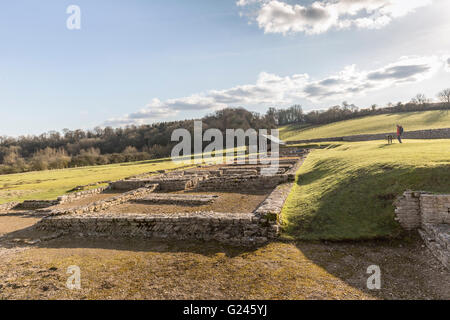Person reading information sign at North Leigh Roman Villa, Oxfordshire, England, UK - Stock Photo