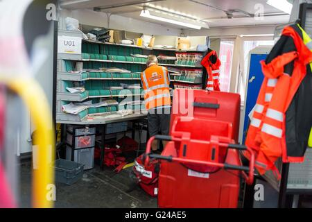 Royal Mail Sorting Office. A man works. - Stock Photo