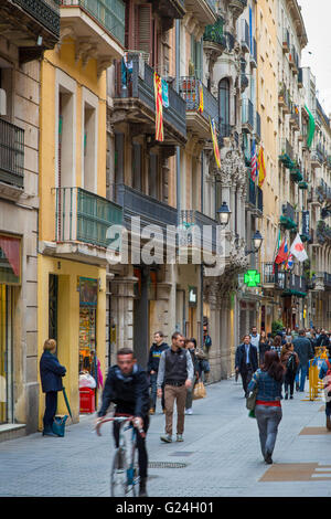 Busy shopping street in old Barcelona, Spain - Stock Photo
