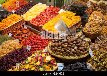 Assorted dried fruit and nuts for sale at La Boqueria, Barcelona, Spain - Stock Photo