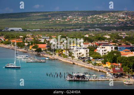 Sailboats and town of Kralendijk on the Caribbean island of Bonaire, West Indies - Stock Photo