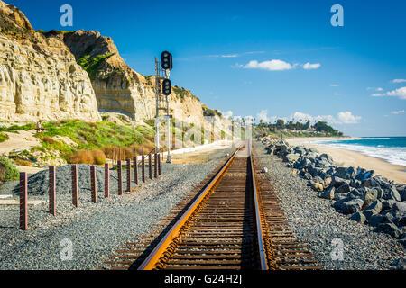 Railroad tracks along the beach in San Clemente, California. - Stock Photo