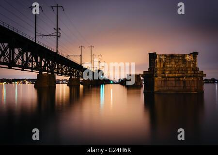 Railroad bridge over the Susquehanna River at night, in Havre de Grace, Maryland. - Stock Photo
